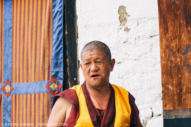 A Monk Eating Doma in Paro, Bhutan
